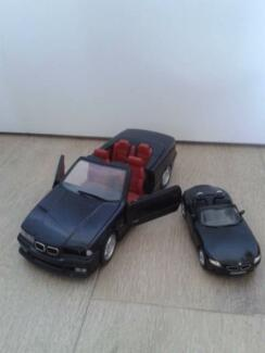 TWO BMW BLACK MINIATURE CARS. PRICE REDUCED