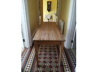 Beautiful rustic long pine table.