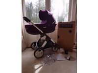 Stokke crusi purple with cap holder and raincover