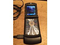 Motorola RAZR V3 mobile phone and charger