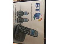 Set of 3 digital cordless phones with answer machine.