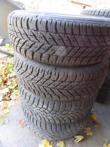 TWO LIKE NEW GOOD YEAR WINTER  TIRES P225/60R16 W/RIMS