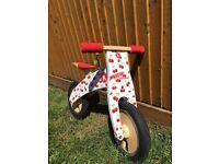 Kiddimoto Curve, wooden balance bike, cherries. Excellent condition.