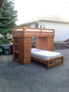 Bunk bed/desk and drawers.