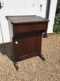 Old school desk with cupboard underneath and ink pot