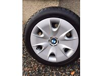 Winter tyres on steel rims with BMW wheel covers