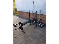 Fitness bench, bars, loads of plates, dumbells etc