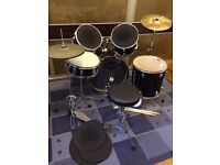 """""""Astro"""" 7-piece drum kit with sound absorbing pads."""