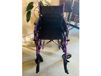 Lightweight purple wheelchair