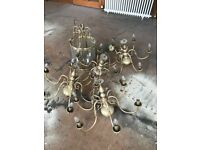 Various brass effect light fittings coming out of an A listed townhouse in Edinburgh West End