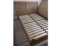 Dreams. King size oak bed frame. Excellent condition. Good solid slatted bed frame. £250
