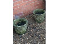 A pair of solid stone planters