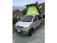 Mazda Bongo with pop up and side conversion including gas hob and sink.