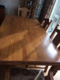 Large solid wood table and six chairs for sale due to house move