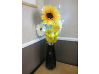 Vase with artificial flowers and twig led lights