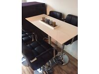 Gloss White High dining table with silver stand and 4 black cushioned high chairs £100
