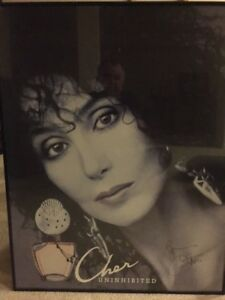 Autographed Cher poster.