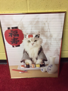 Gold colored framed picture of Sushi Chef cat