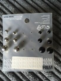 H & M silver and black ball style earrings - new in pack - 50p !