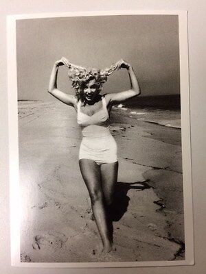 Marilyn MONROE POSTCARD 1957 in white swimuit holding hair on beach by Sam Shaw