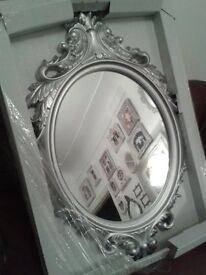 large silver ornate oval mirror new in the box 20.00 wavertree ready to hang .. brackets on the back