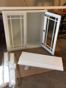 White painted birch cabinet with glass doors