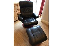 Black leather swivel chair with matching footstool