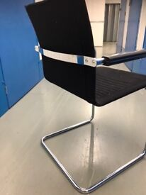 Metal framed chairs - black material seat and back