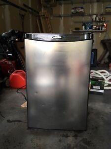 mini fridge, keurig, side tables, pitures, work jacket