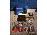 1tb PlayStation 4 pro with two controllers and headset and 7 games and all cables in oringinal box