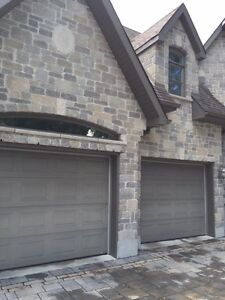 GARAGE DOORS   9 X 7   2 DOORS AVAILABLE