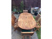 Patio teak table and 6 matching chairs