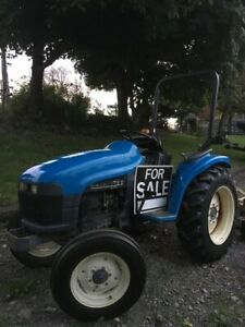 New Holland 1725 Tractor with Attachments