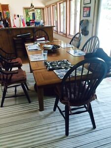 Oak dining table and matching chairs