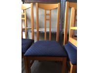 Set of 4 matching wooden dining chairs with navy blue upholstery