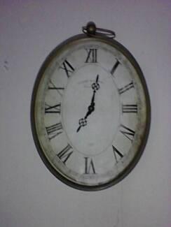 oval  battery wall clock
