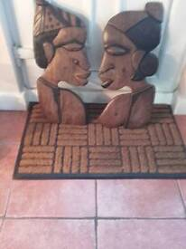 Two African wooden face carvings