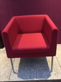 Upholstered red tub chair