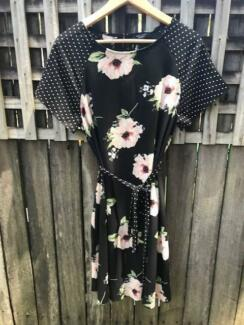 Collection of maternity dresses, tops, shorts and swimmers.