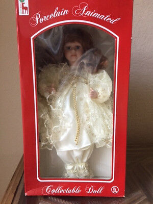 Brand New Still in the Box Santa's Best Porcelein Animated RedHead Doll (Animated Doll)