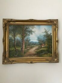A Woodland Scene Painting With Gold Coloured Frame