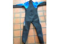 2 Wetsuits and beach shoes - suitable for children