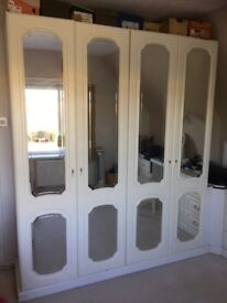 Wardrobe with two sets of drawers,corner storage unit and dressing table with stool