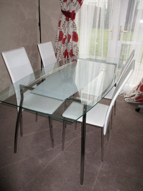 Glass dining table, 4 chairs. Ikea Serri oval table, frosted detail, chrome legs. Table/desk seats 6