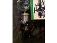 2 brand new sea fishing reels in boxes one loaded with braid
