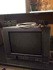 "15"" Toshiba Stereo TV, Remote, RCA Cable, Coaxial Cable."