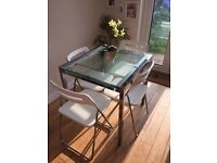 IKEA GLIVARP Glass extending table and 4 NISSE folding chairs in white. VGC