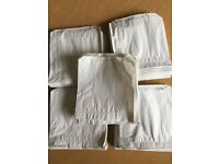 "5"" x 5"" white paper bags. Been stored in a tin. Over 500. (sweet bags)"