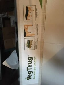 Two brand new raised planter boxes