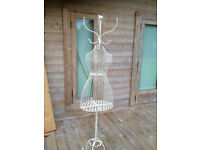 Beautiful steel basket mannequin with hat or coat top and storage in main body